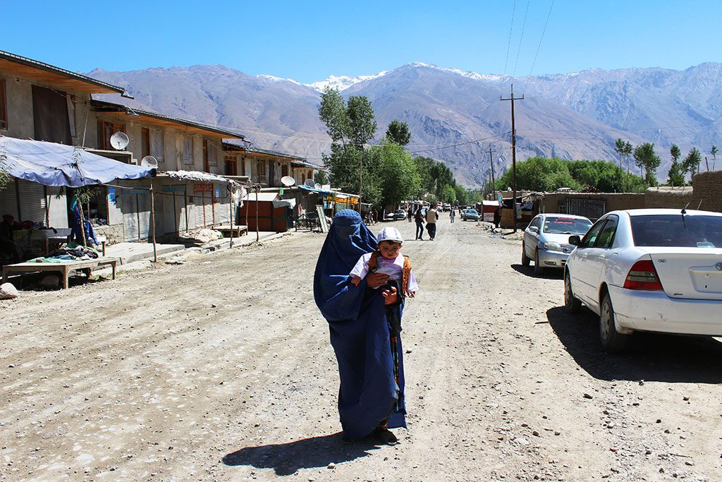 Afghan woman in burkha with child