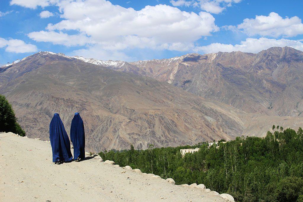 Two Afghan women in blue burkhas