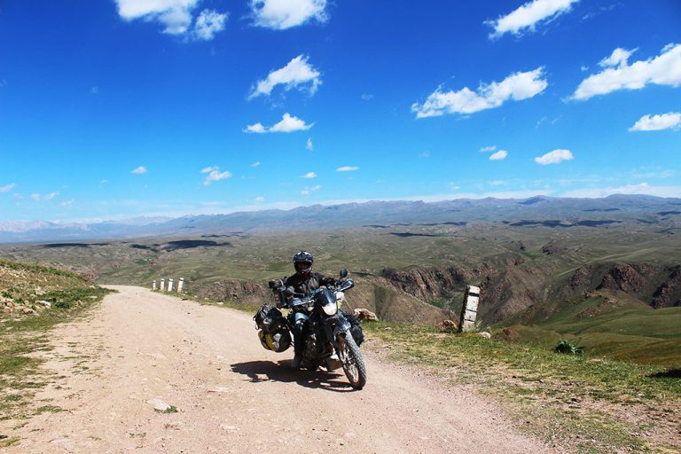 Overland adventure motorcycle riding through Kyrgyzstan
