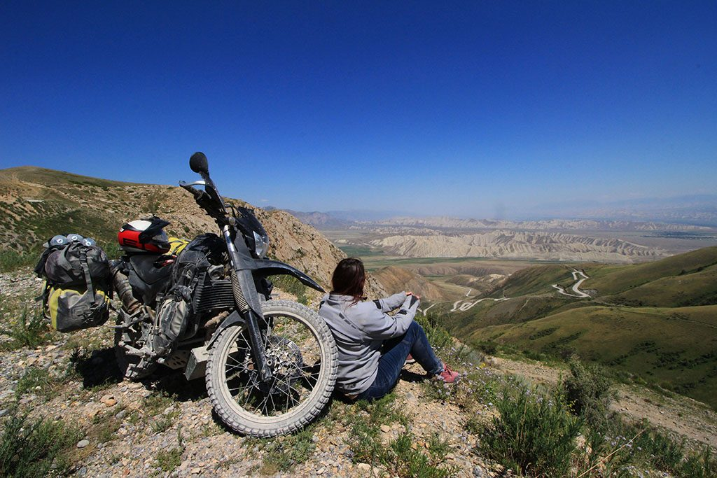 Motorcycle travelling through epic Kyrgyzstan