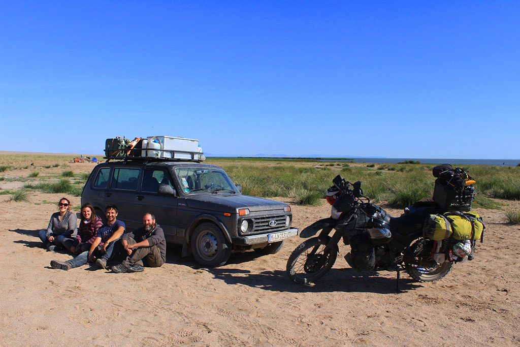 a motorcycle and a lada travelling through Mongolia