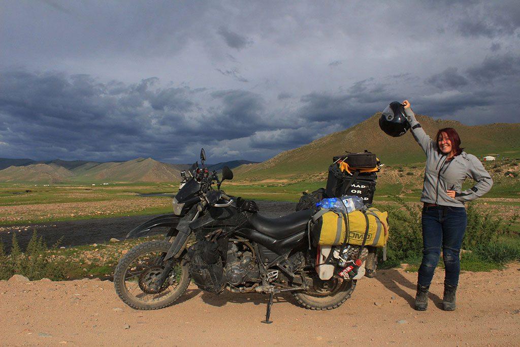 Girl adventuring biking in Mongolia