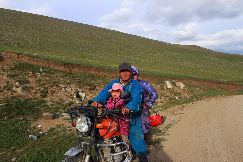A Mongolian family on their motorbike