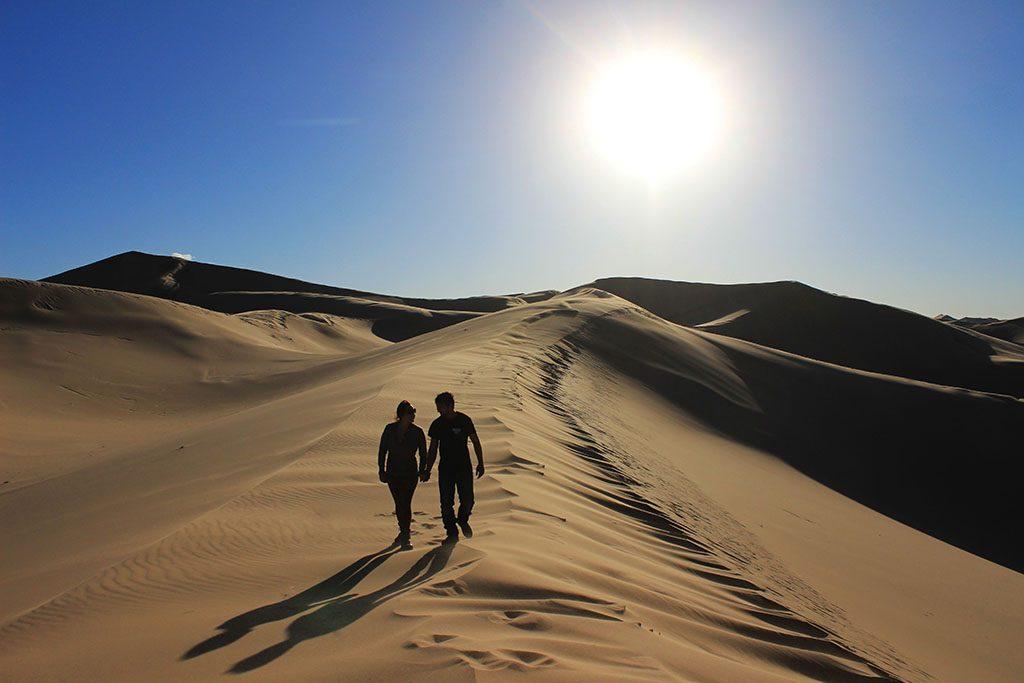 Guide to the Gobi Desert in Mongolia walking on sand dunes