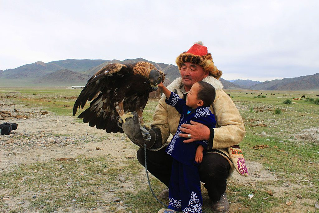Eagle hunter family in Mongolia with his grandson