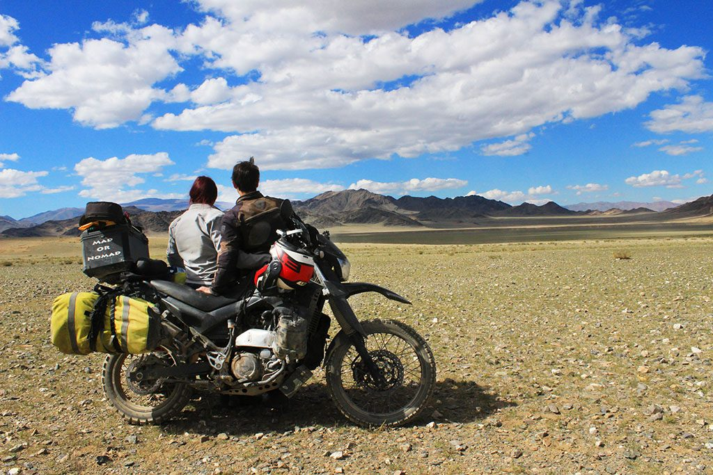 Adventure Motorcycle Travel in Mongolia blue skies