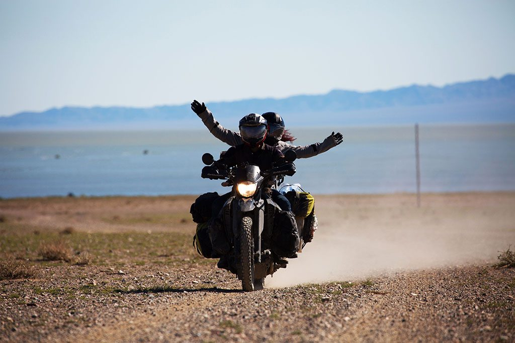 Couple motorcycle travel through Mongolia